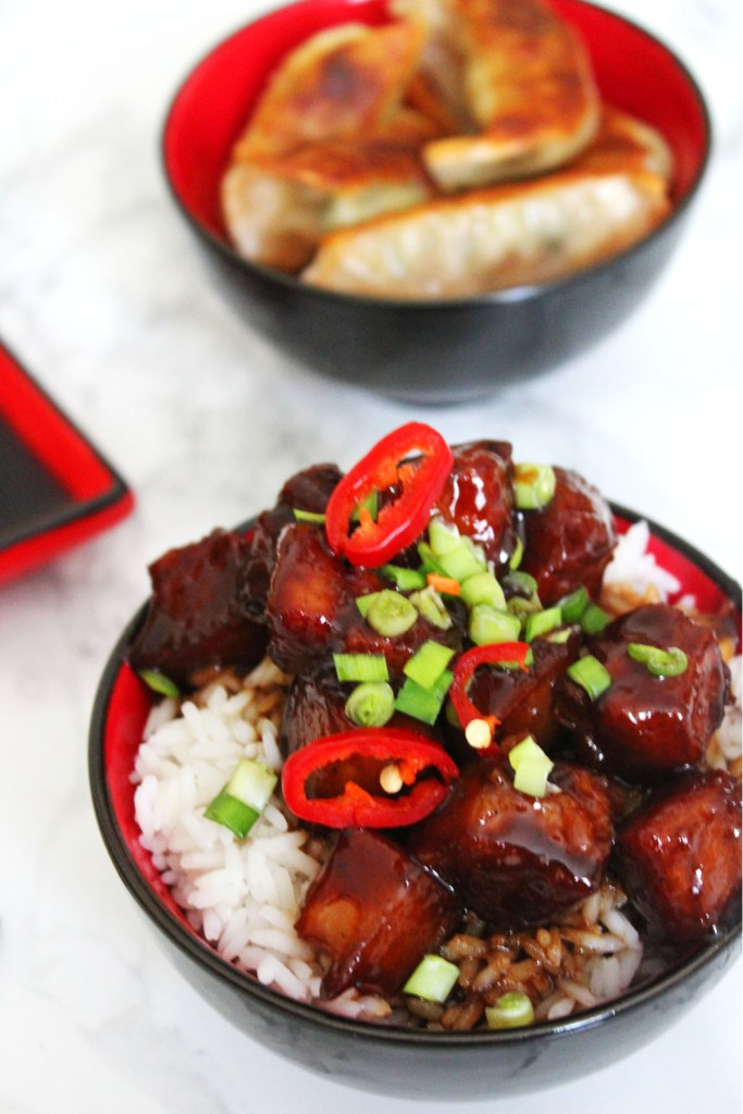 Sweet and Spicy Pork Belly is enrobed in a super sticky sauce a wonderful Chinese New Year dish