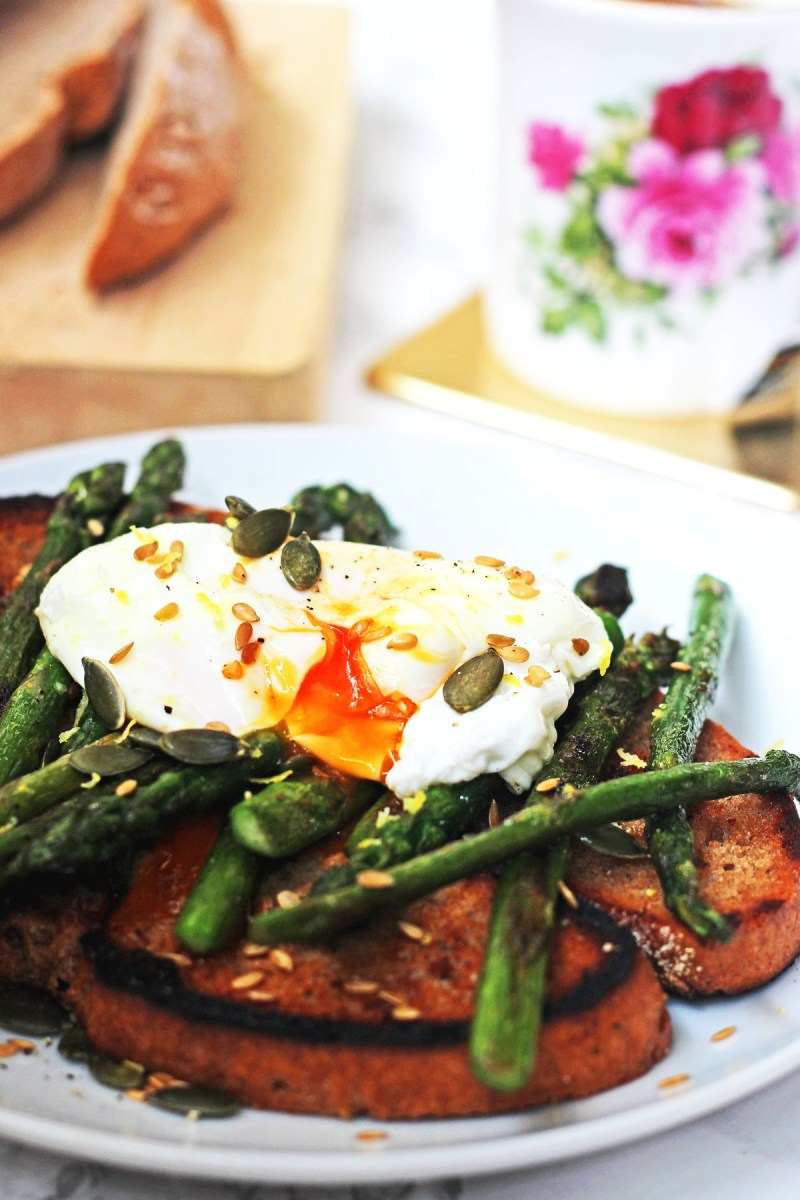 Brighten up breakfast with griddled asparagus and poached egg on toast golden linseed and pumpkin seeds
