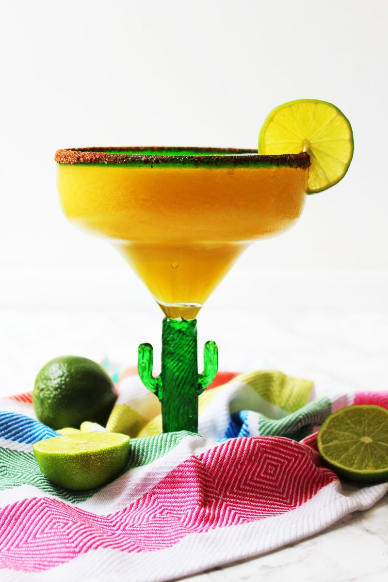 This Frozen Mango Margarita is a fun twist on the classic Mexican cocktail. Perfect for Cinco De Mayo or a hot summer day! Fiesta! Get the recipe at Supper in the Suburbs!