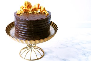 This Cinder Toffee Bonfire Cake is smothered in milk and dark chocolate ganache and topped with honey comb