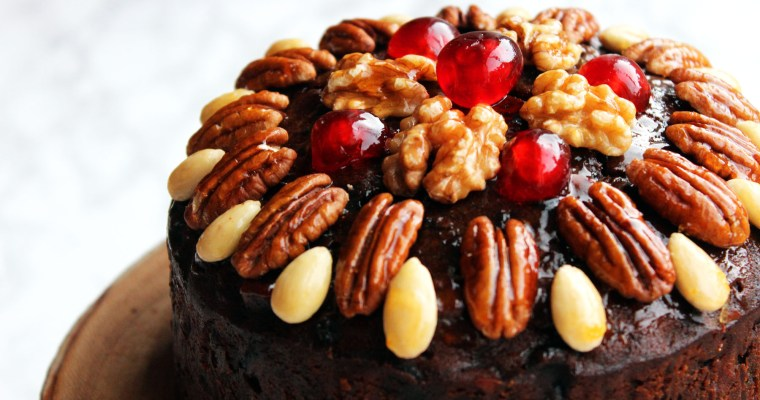 Naked Christmas Cake with Glazed Nuts and Cherries