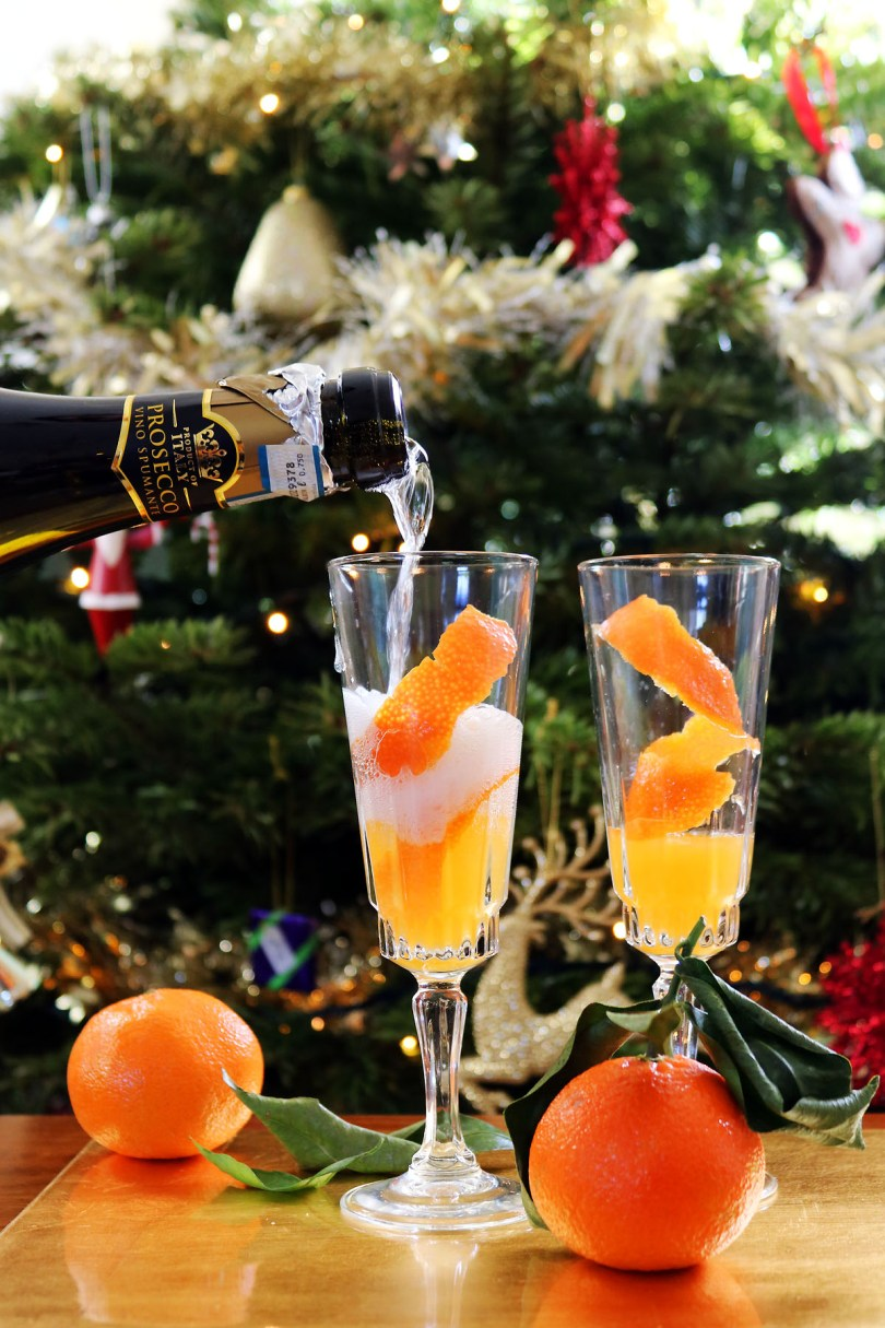 Prosecco poured over clementine juice is the perfect New Years Eve party cocktail or New Years Day brunch cocktail. Get the recipe at Supper in the Suburbs!