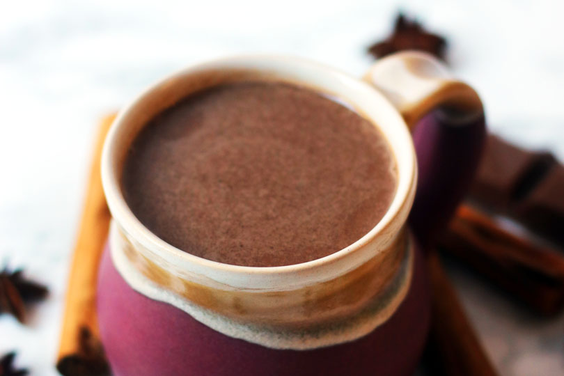A mug of cinnamon and amaretto hot chocolate, the perfect hot drink for warming up at Christmas.