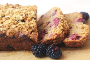 Apple and Blackberry Crumble Cake cut into slices