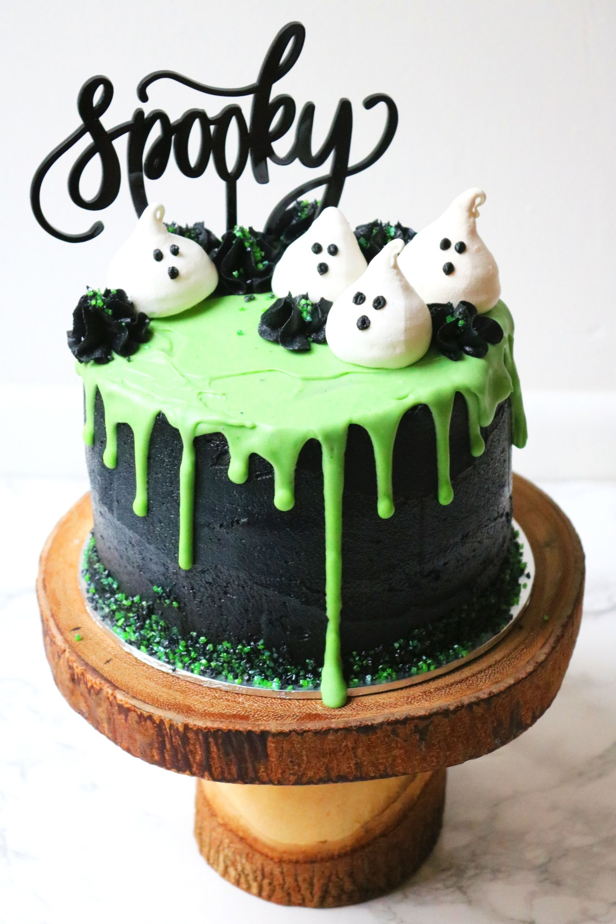 Halloween Layer Cake Coconut And Lime Slime Decorated With Black Buttercream Green