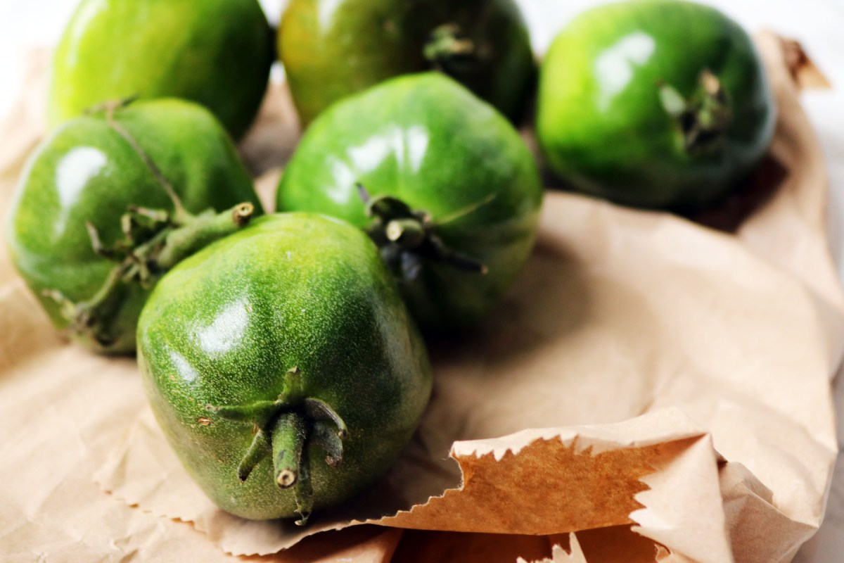Green tomatoes and a brown paper bag