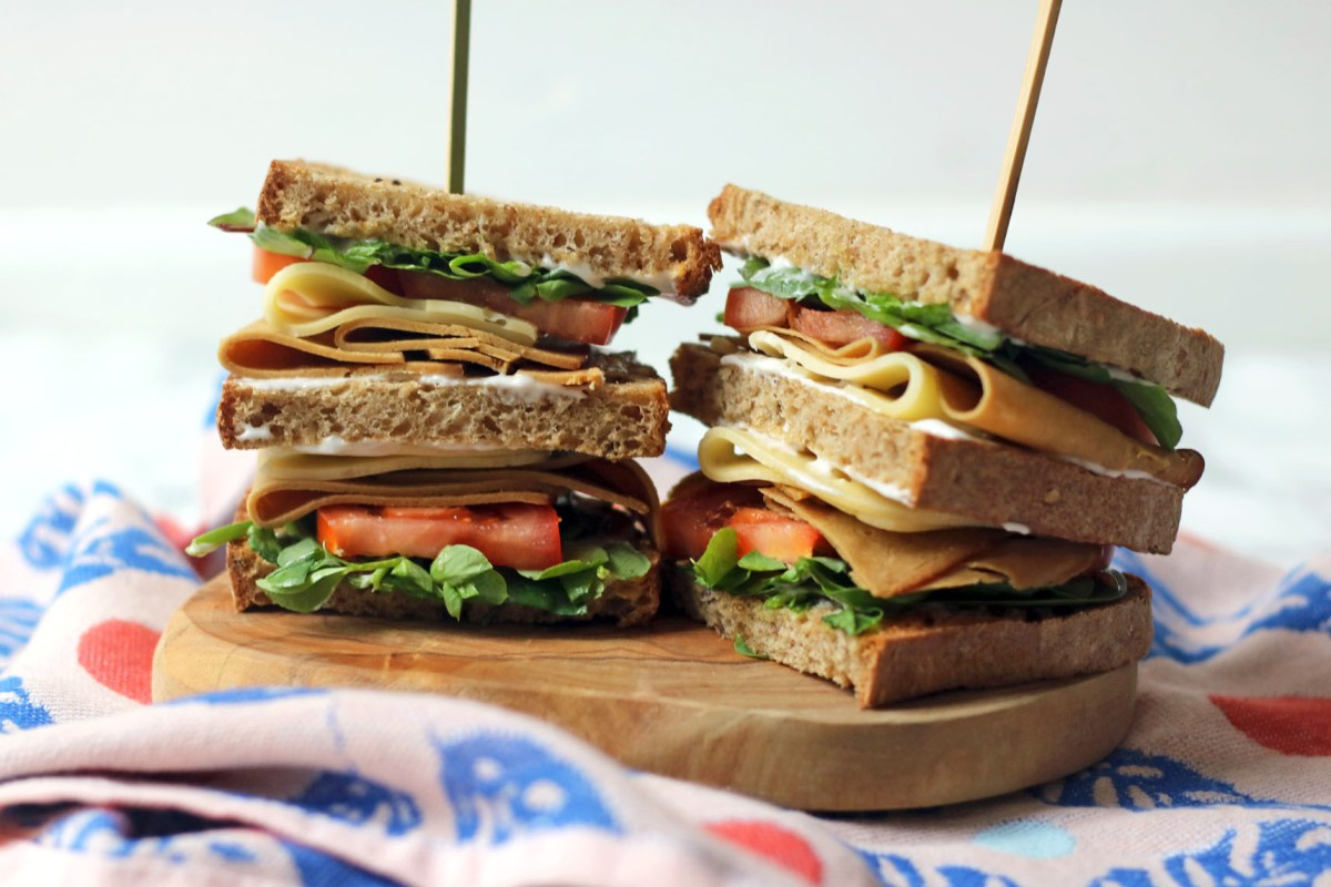 All the layers of a vegan club sandwich