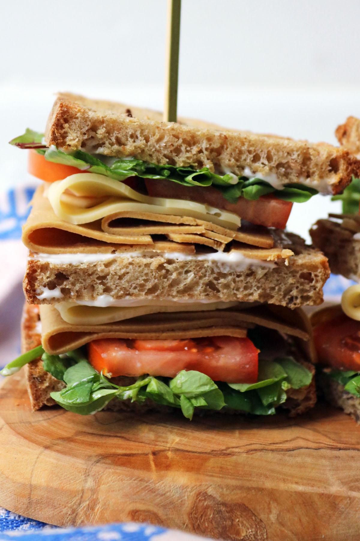 Close up of half a vegan club sandwich