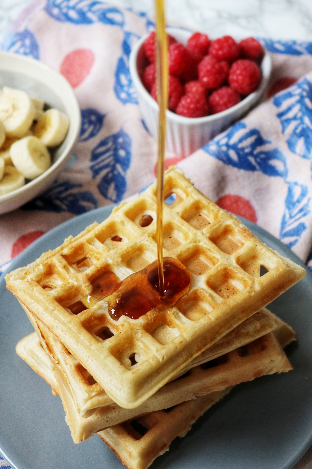 Sourdough waffles drizzled with maple syrup