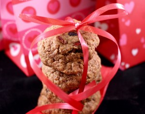 Whole Grain Cinnamon Oatmeal and Fruit Cookie with  a red bow in front of a valentine's day box