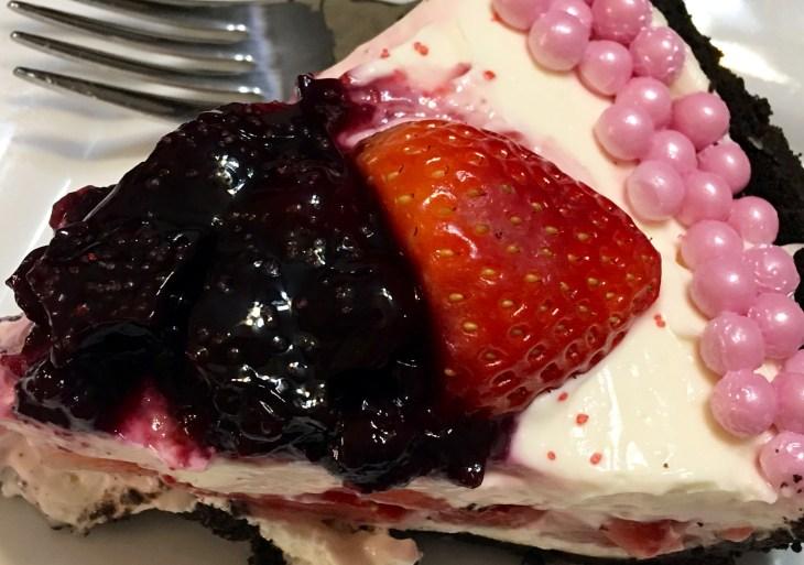 A slice of Mixed Berry No Bake Oreo Cheesecake