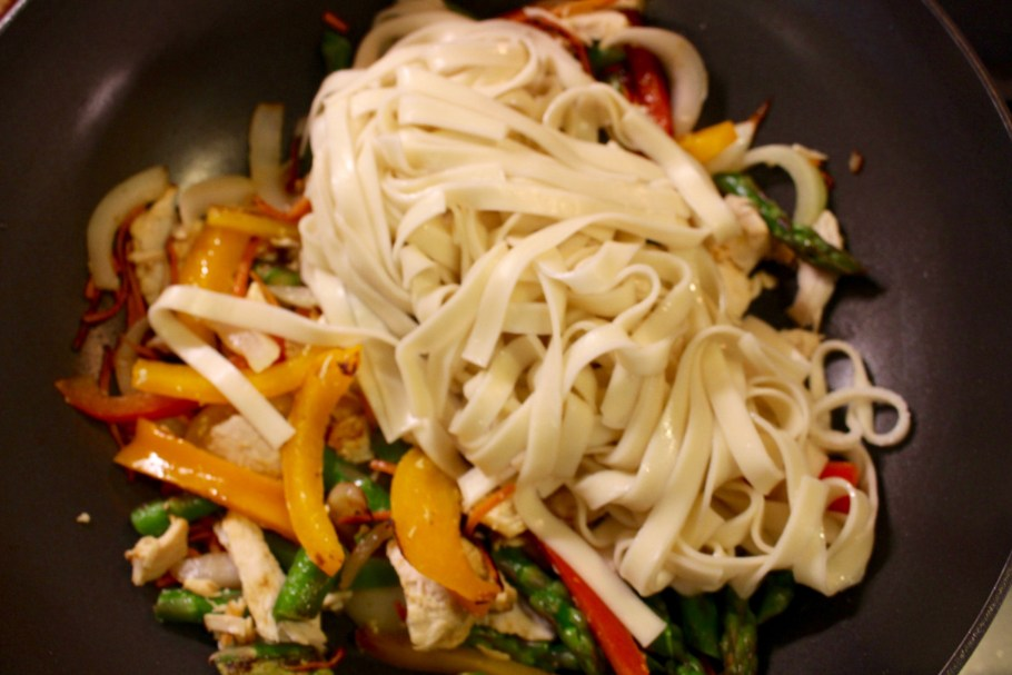 Stir Fry in Wok with Veggies and Chicken and Chinese Noodles