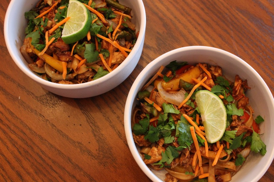 Two Easy Chicken Stir Fry with Noodles in white bowls top view