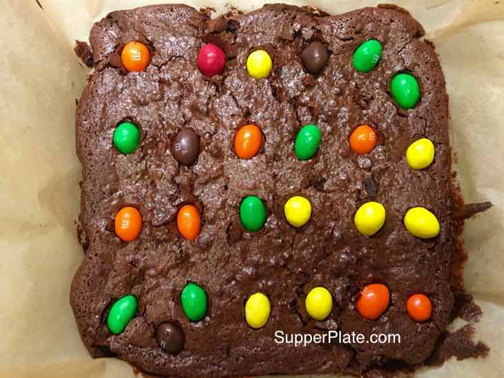 Ultimate Gooey Chocolate Brownies cooling with peanut m&ms as a topping