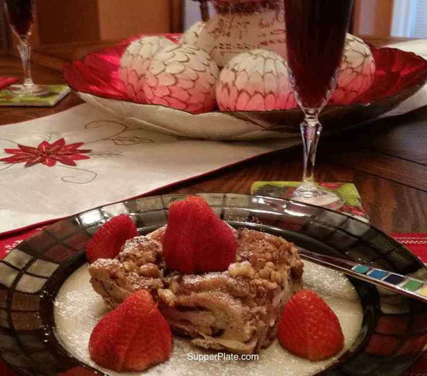 Cinnamon French Toast Bake Plated with berries and Christmas decorations in the background