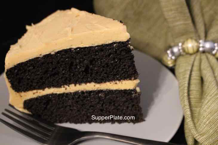Homemade Chocolate Cake on a green plate with fork and napkin