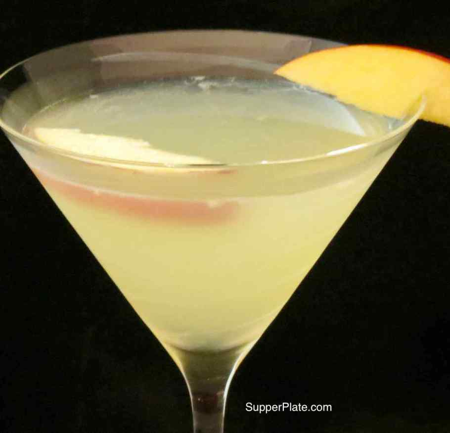 Closeup of the Apple Martini with an apple slice on the rim and in the martini glass