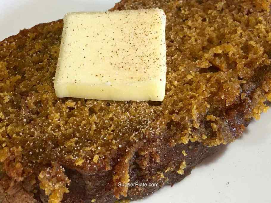 Pumpkin Cinnamon Bread topped with butter and cinnamon sugar