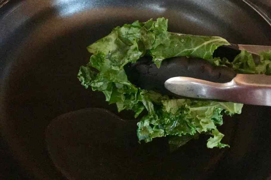 Water added to a frying pan with the first addition of Kale