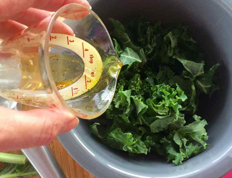 Adding the dressing to the Kale