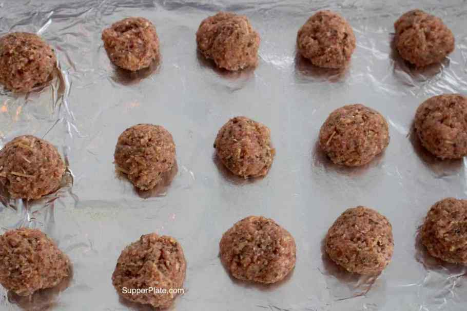 Meatballs on a cookie sheet lined with foil
