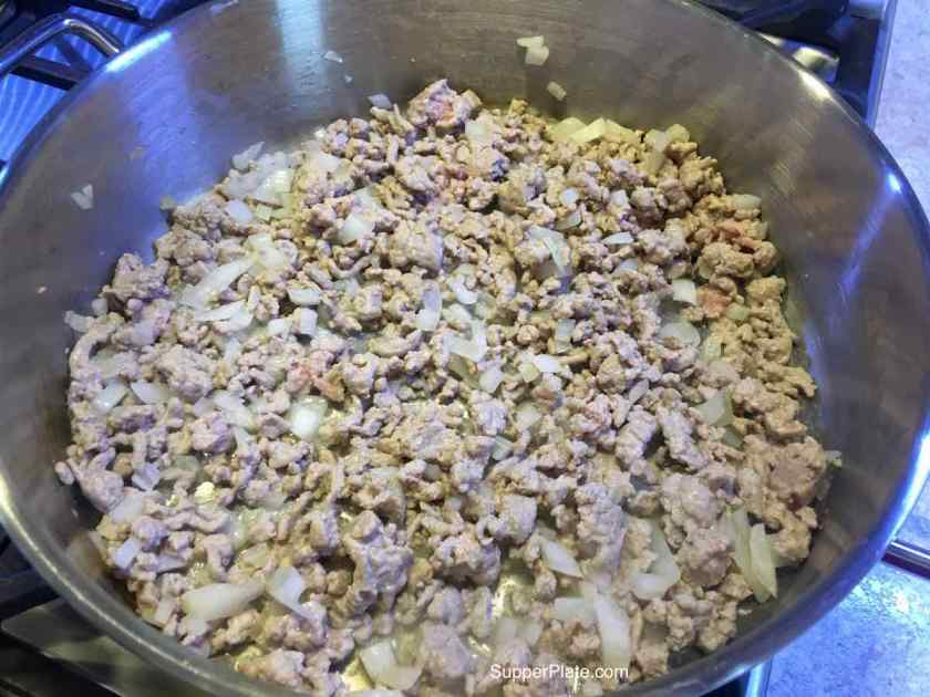 Cooking onions and ground turkey in a soup pot
