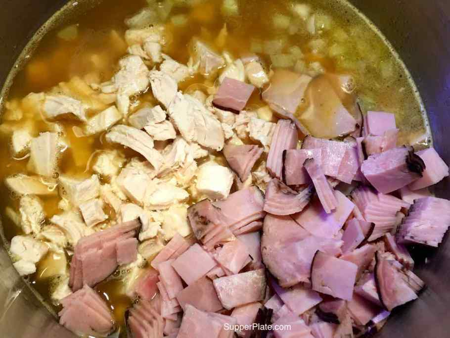 Adding chicken and ham to the soup