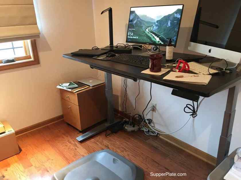 Standing computer desk with computers