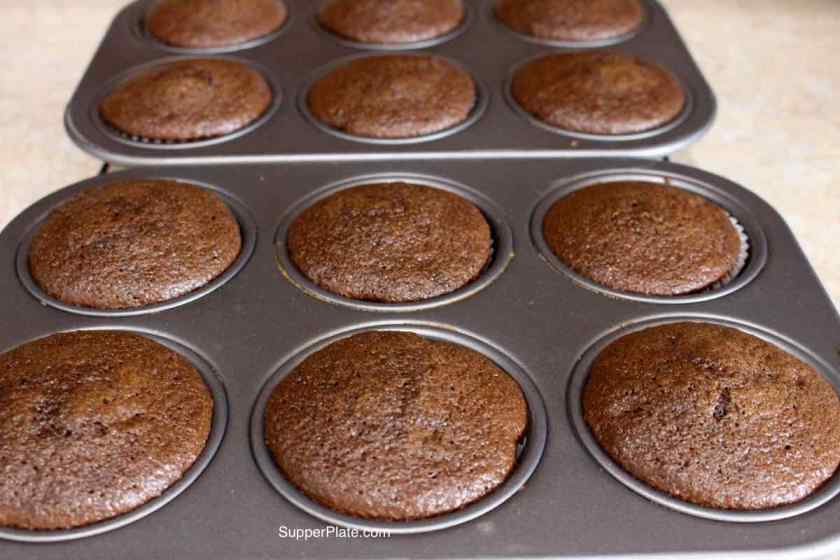 Cupcakes out of the oven in cupcake pans