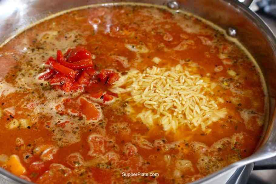 Red peppers and orzo pasta added to the soup