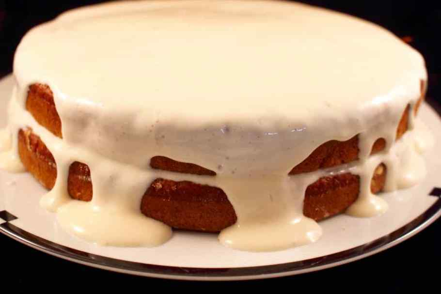 Two layer Carrot Applesauce Cake with a thin frosting