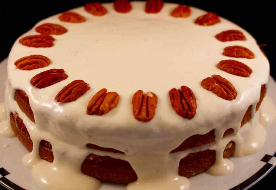 Two layer cake with whole pecans on the top