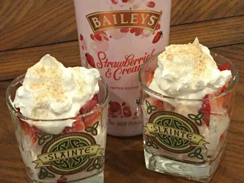 Irish Glasses with whipped cream and strawberries with Baileys Strawberries and Cream bottle