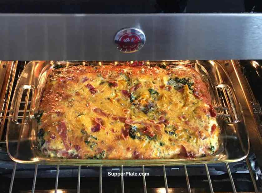Breakfast Casserole with Bacon cooking in the oven