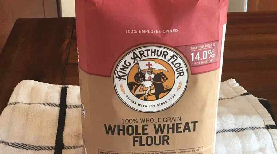 A bag of whole wheat flour on a table