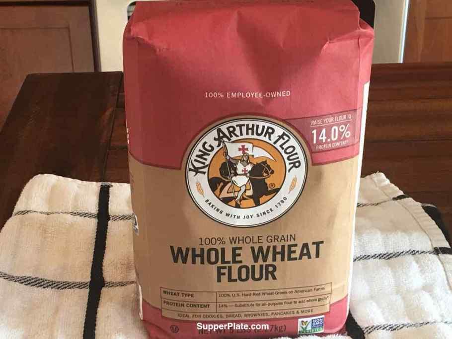 A bag of whole wheat flour on a table