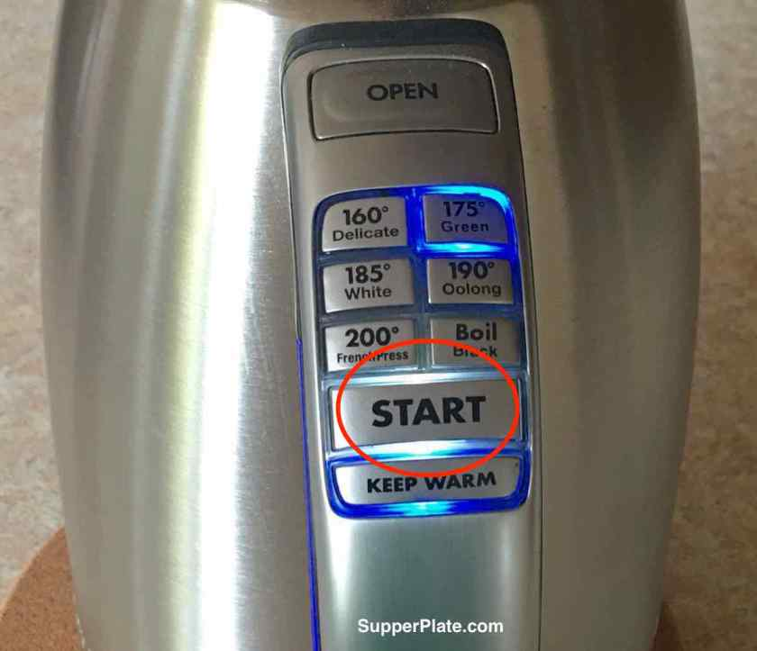 The start button is pressed and is light up with a red circle around it