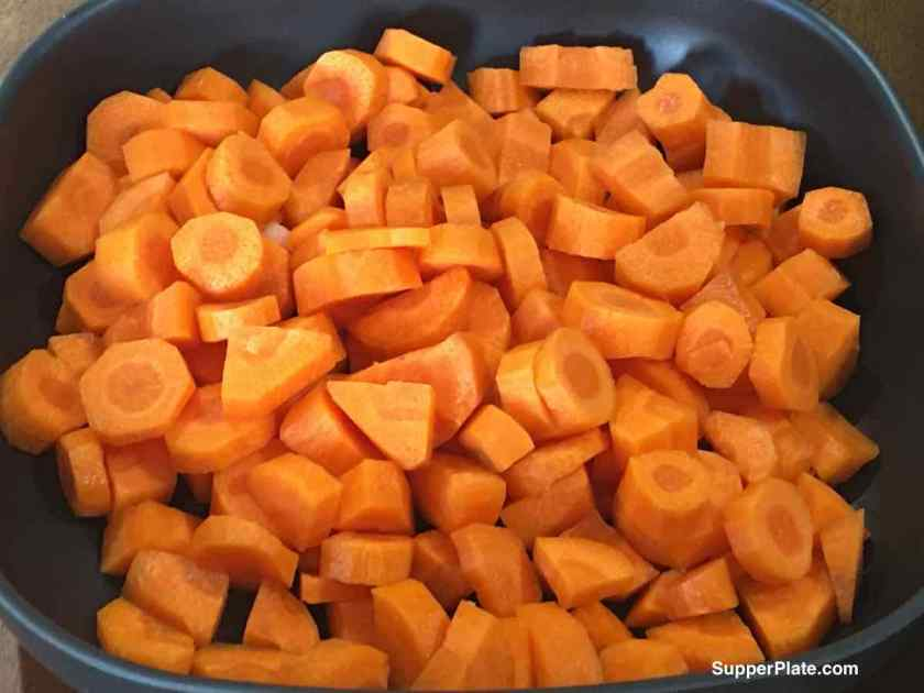 Chopped Carrots in a black bowl