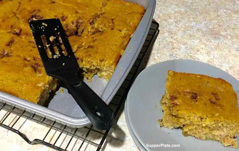 Rhubarb Coffee Cake on a green plate next to the coffee cake pan