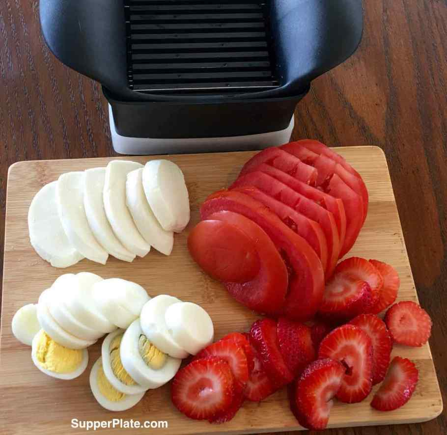 Top view of quick slice with sliced cheese eggs tomatoes strawberries