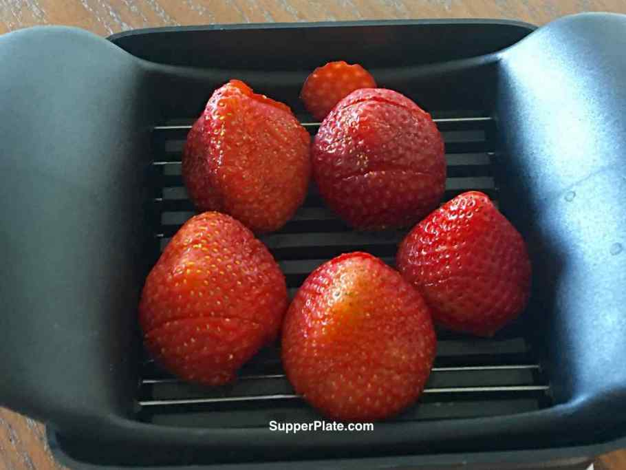 Top view of sliced strawberries on quick slice