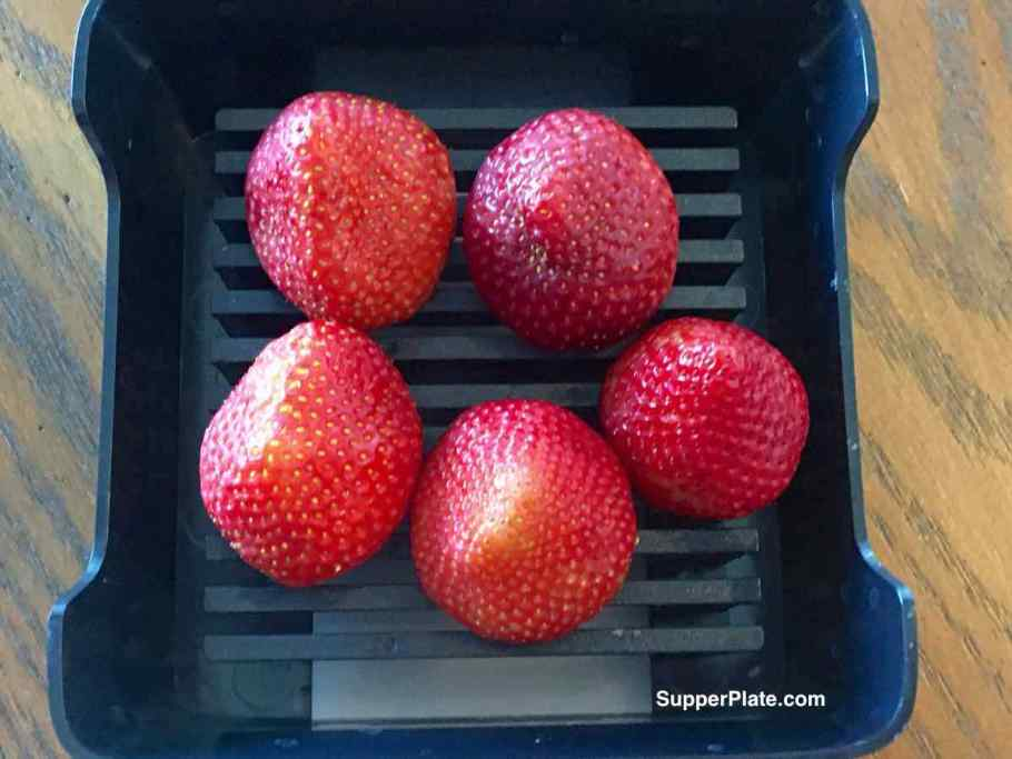 Top view of whole strawberries on quick slice