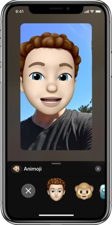 screen showing a person using FaceTime with a Memoji