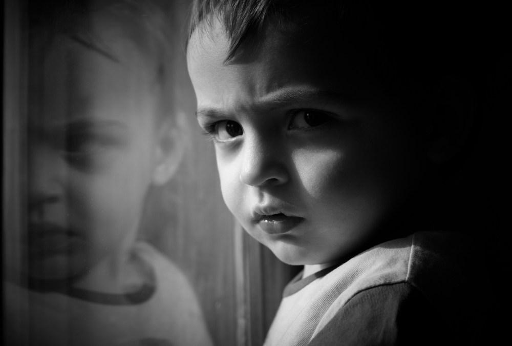 A sad little boy. Behavior charts can cause problems with self-esteem.