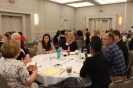 Photo: Attendees from the South Dakota and Alabama teams in discussion at their table