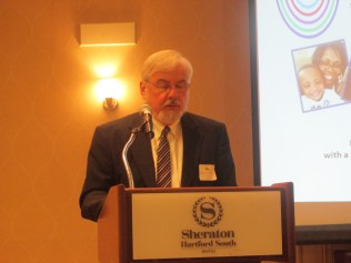 Photo: Commissioner Terry Macy, DDS , welcomes attendees at second annual statewide Community of Practice event.