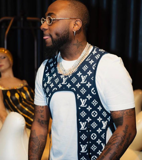 Davido reveals the face of his son, Ifeanyi on N150million customized Diamond necklace