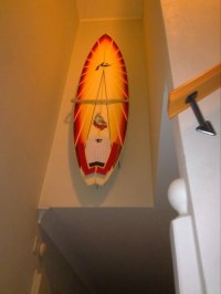 Surfboard mounted in staircase  Surfboard Wall Mount