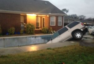 SUV in Pool photo source WAFF