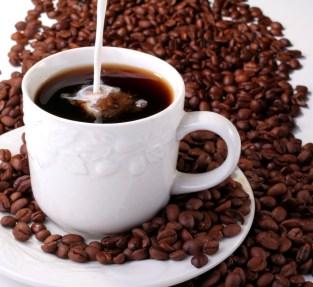 cream pouring into hot coffee (2)